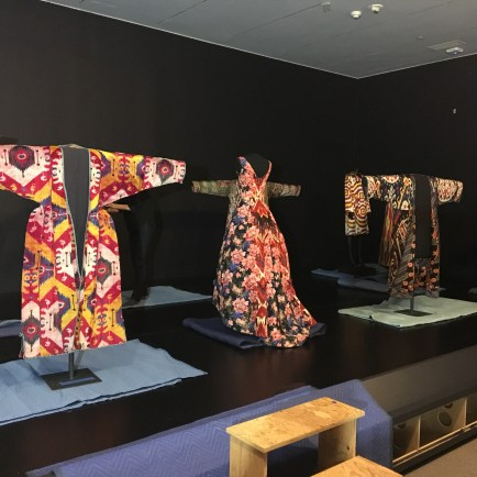 seven mannequins on display wearing various ikats prints
