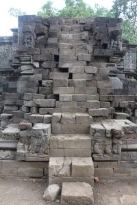 Platform-style temple with relief carvings on all sides
