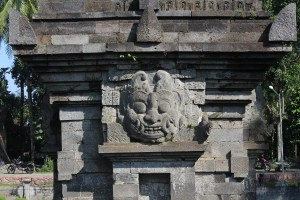 Demon face over a niche