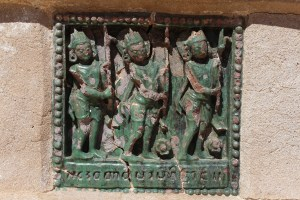 Stucco tile with three figures in profile