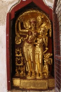 Gilt stucco sculpture of two female deities in a niche