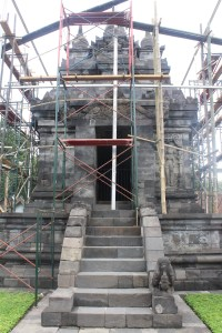 Stone temple covered by wood scaffolding