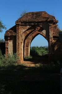 Partially ruined brick gate