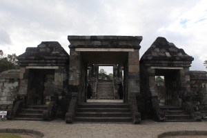 Triple-doorway with stone steps leading upwards