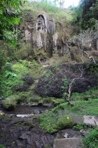 Small rock-cut shrine in the river ravine seen from below