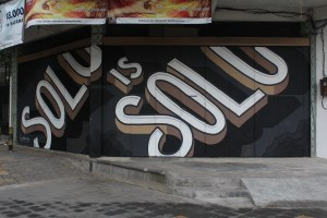 """Black and white wall mural reading """"Solo is Solo"""""""