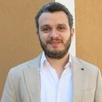 headshot of Alain George