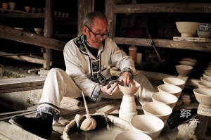 Elderly man shaping a bowl