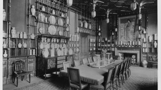 Black and white photo of the peacock room, showing shelves full of china