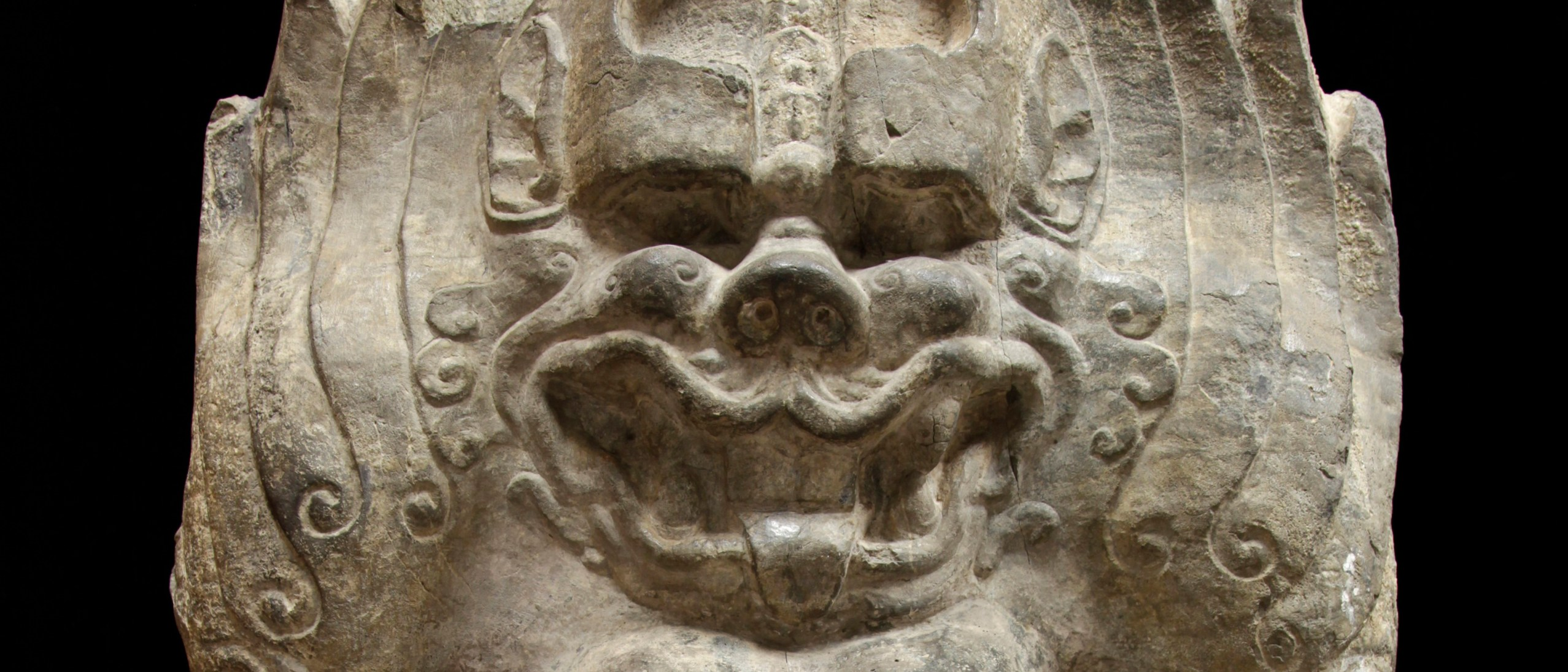 Snarling face of a stone carved monster