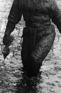 a black and white photo of a a muddy body