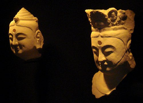Bright yellow printed plastic replicas of statue heads