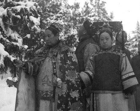 Cixi is shown with various ladies and eunuchs