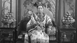 Cixi on throne flanked by bowls of apples