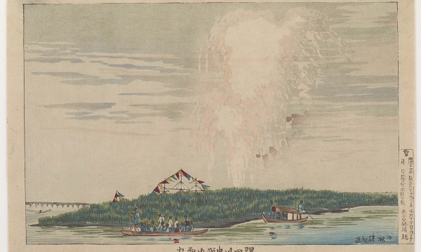 A watery explosion from a torpedo against the daytime sky like fireworks.