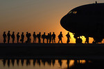 Free Stock Photo: Soldiers boarding a plane at sunset
