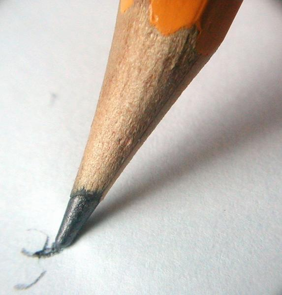 Free Stock photo: Closeup of a pencil writing on paper.