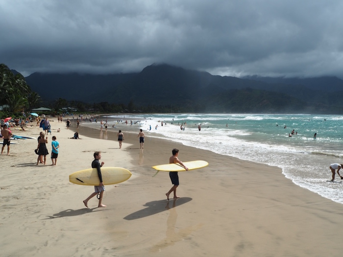 Surfers on Hanalei Bay