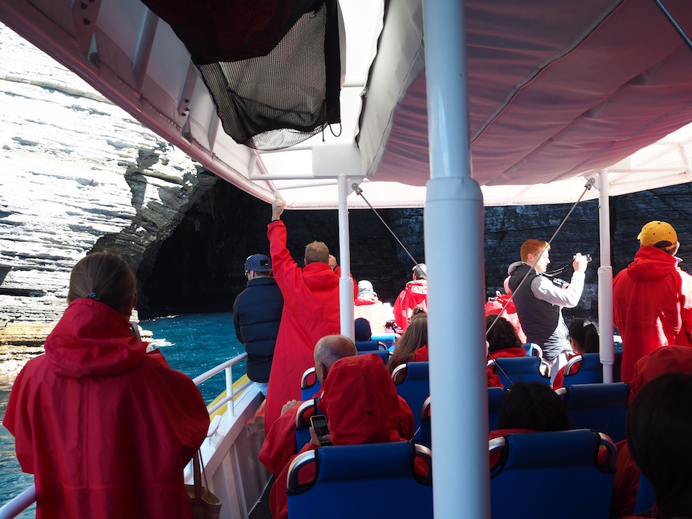 The boat navigating inside a cave.