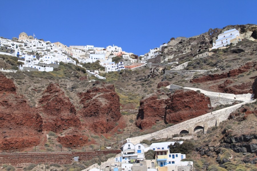 Oia on the top of the cliff and the old port of Ammoudi at the bottom.