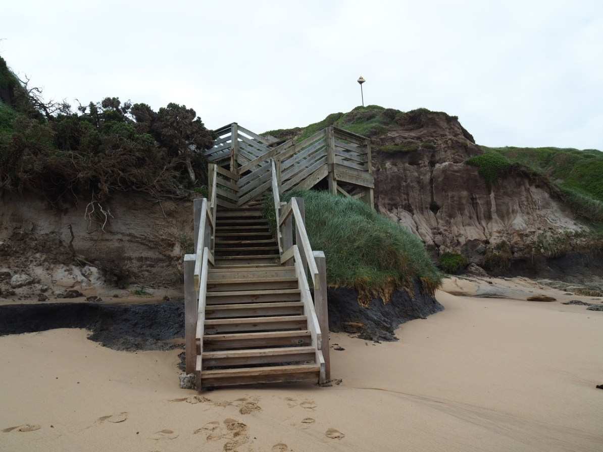 The stairs taking us to the top of the sand dunes.