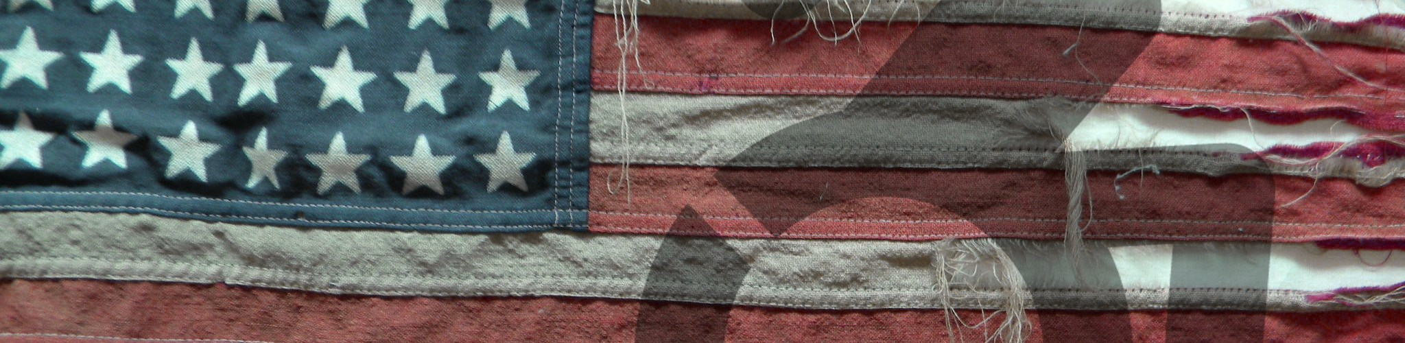 Tattered American Flag with wheelchair symbol. Priotesting Donald Trump because he promotes discrimination against people with disabilities.