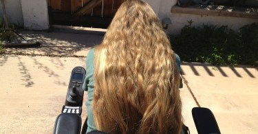 Having long hair symbolizes my right to make choices about my life as a person with a disability.
