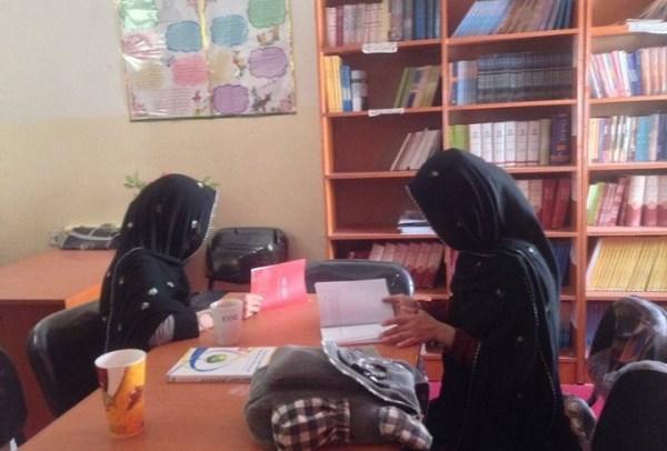 Afghan women reading Helmand Afghanistan
