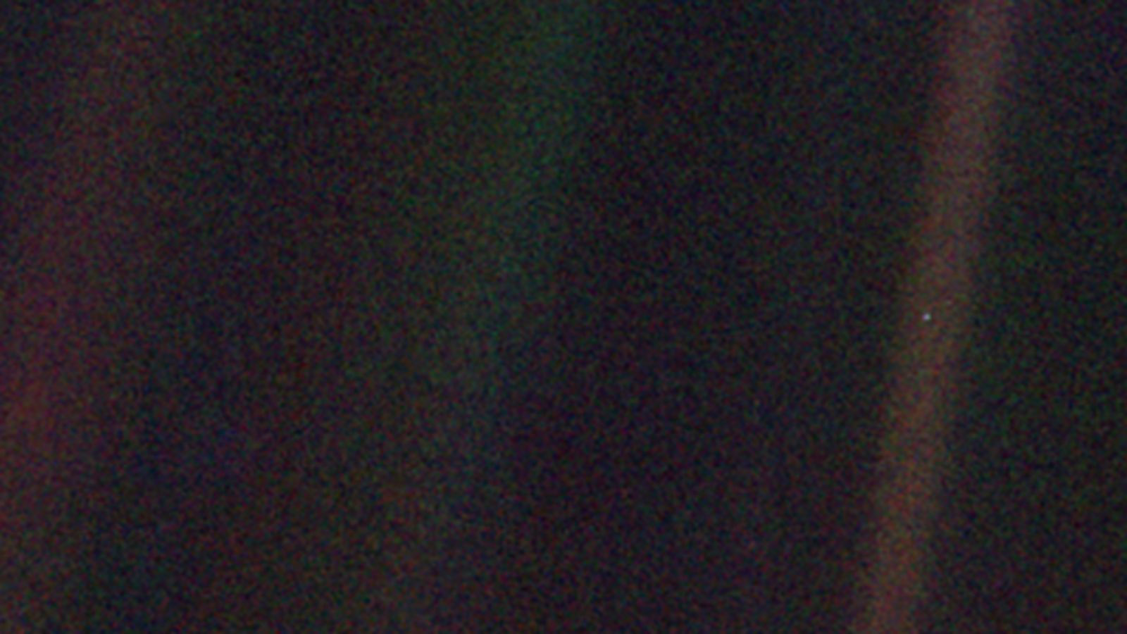 Picture of Earth as seen from Voyager I as it was leaving our solar system