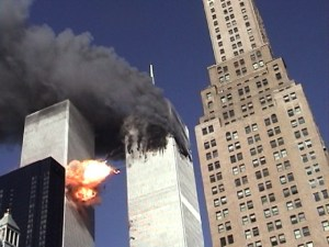 September 11, 2001 - World Trade Center Tower 1 is ablaze. Tower 2 gets hit. The view of the oncoming 767 airplane was blocked by the dark-glass 50-story Millennium Hilton Hotel. The pulverized parts of the fast-moving plane and its passengers burst forth. (2) Neil deGrasse Tyson