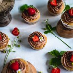 Berry cupcakes with chocolate frosting