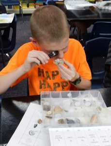 Learning to use a loupe to view details of fossils