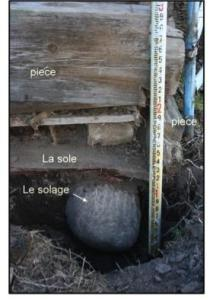 Fig. 6 : Here you can see the solage, or granite foundation boulder.