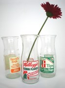 Vintage recycled milk bottle vases by Who's? Glass