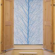 Blue tree design roller blind