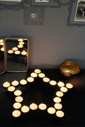 Black star tea light candle holder