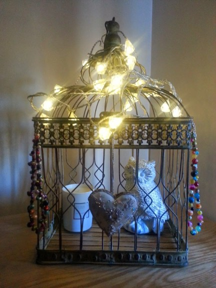 How to use a hanging bird cage as a jewellery storage display case