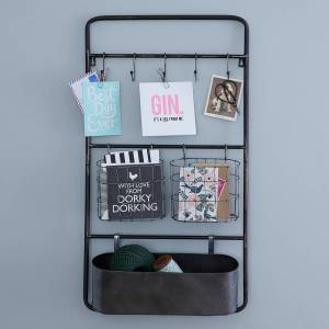 Useful industrial style metal wall storage unit that would work in so many rooms.