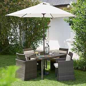 Contemporary rattan furniture helps create the boutique hotel terrace look