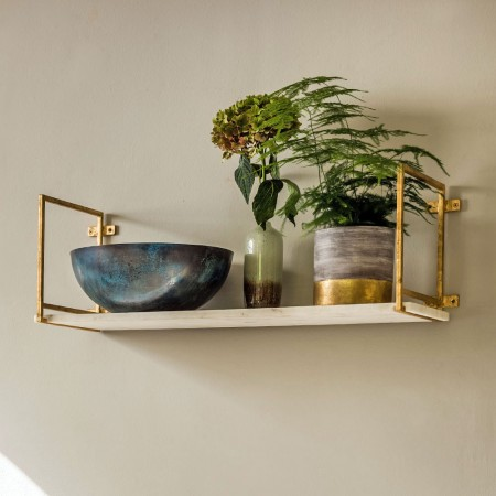 Two home trends combined, with this metallic gold and marble shelf.
