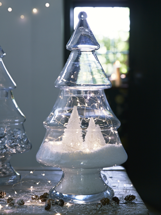 Glass Christmas tree jar styled with mini white trees and a snowy scene inside