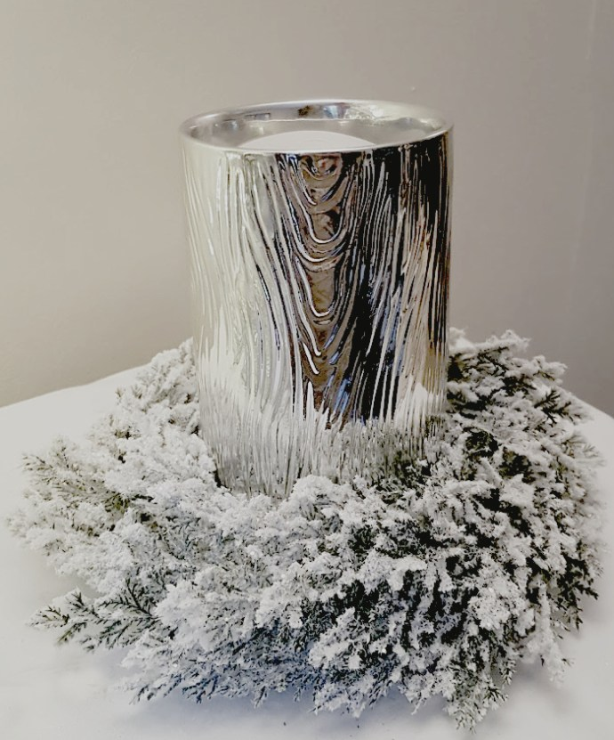 Christmas scented candle and frosted wreath - great for a table decoration