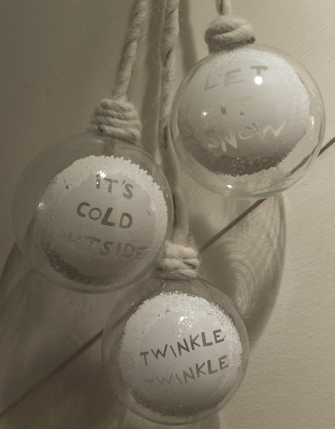 Large white baubles make an attractive hanging Christmas decoration