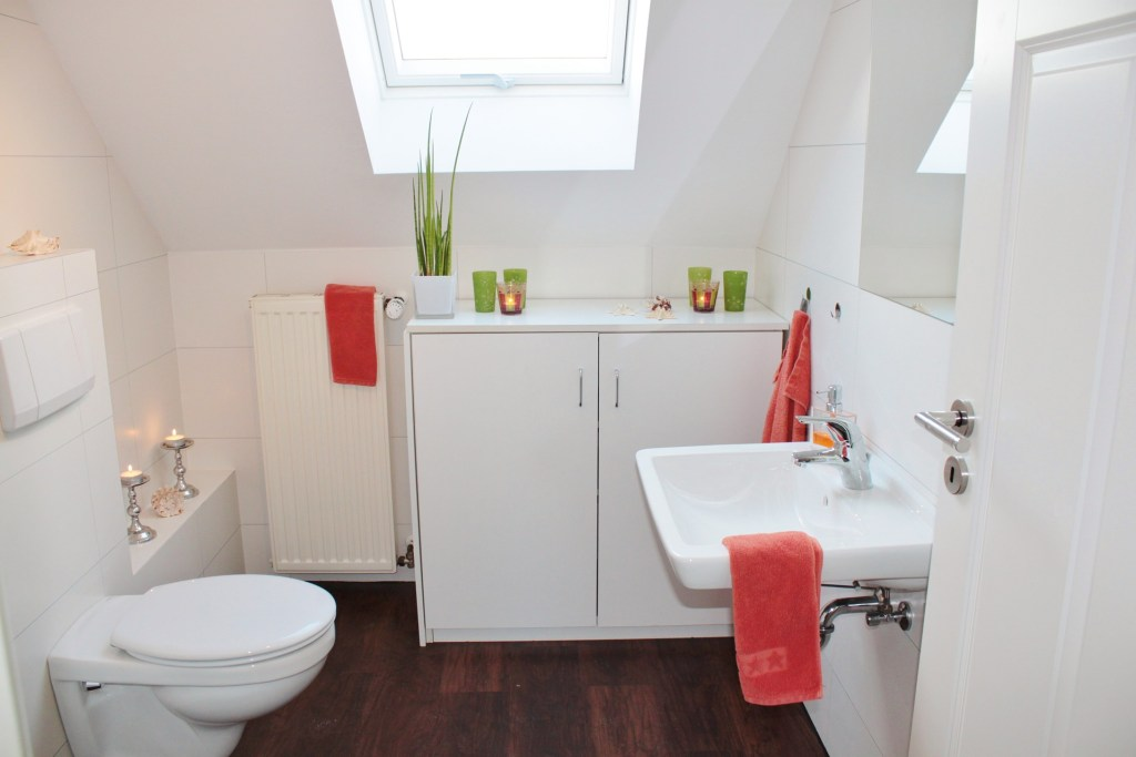 Add some colour to a white bathroom through the use of towels and other accessories