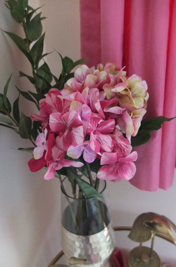 Gorgeous faux pink hydrangeas make a lovely guest room floral arrangement