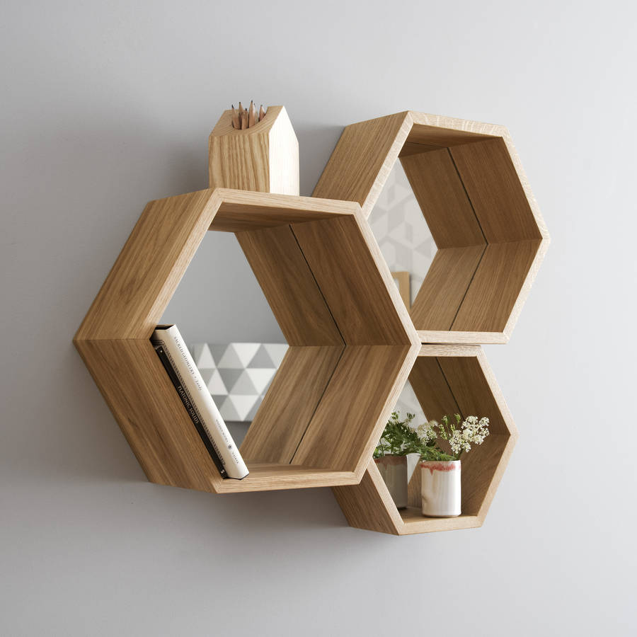 Love these hexagon design shelves with mirrored backs