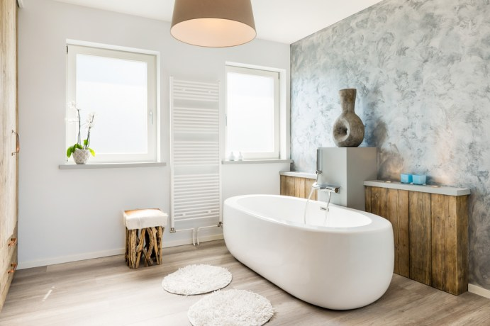 Create a calming seaside inspired oasis in your bathroom, using pale colours, driftwood accents and shells