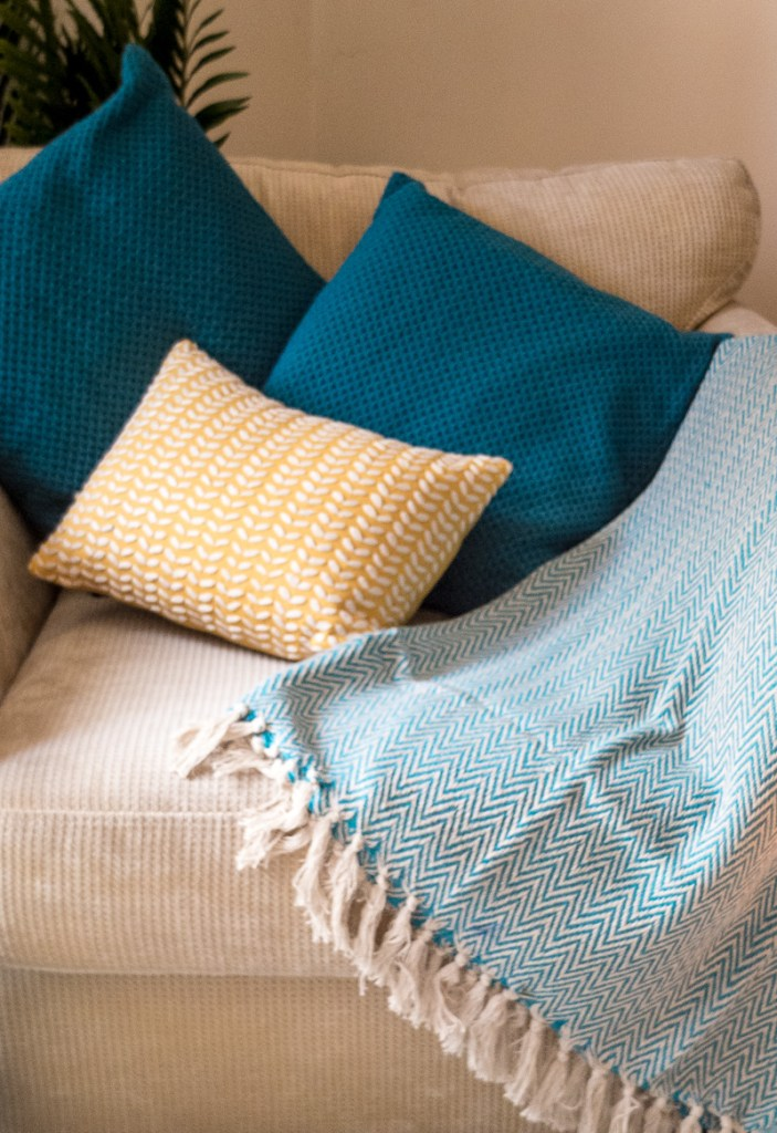 Add a pop of colour to your chairs with these teal textured cushion covers