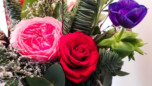 Gorgeous fresh scented roses are included in the Christmas posy bouquet from The Real Flower Company