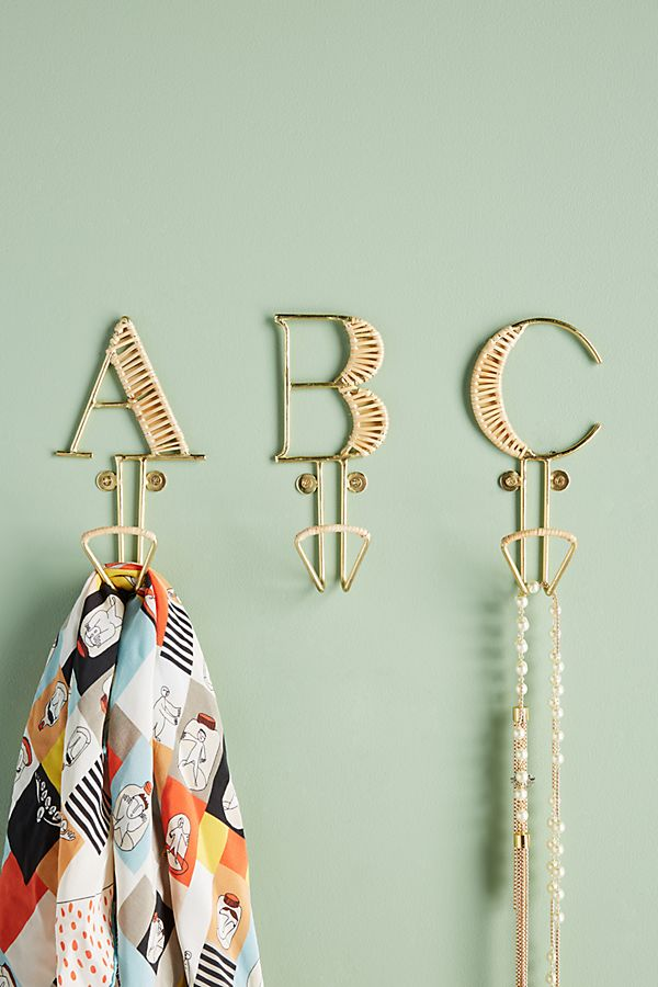 Stylish monogram brass effect wall hooks - use one on its own or spell our a word with several!